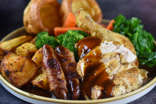 Roast Chicken with pigs in blankets, veg and yorkshire puddings