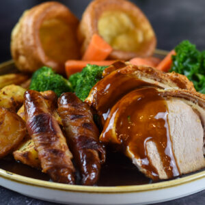 Roast Pork with pigs in blankets, veg and yorkshire puddings