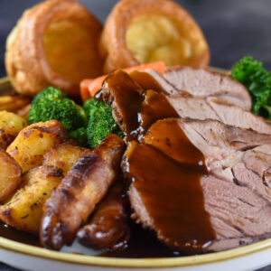 Roast Lamb with pigs in blankets, veg and yorkshire puddings