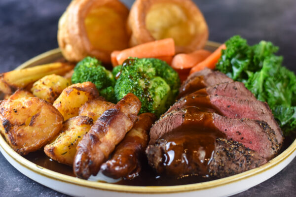 Roast Beef with pigs in blankets, veg and yorkshire puddings